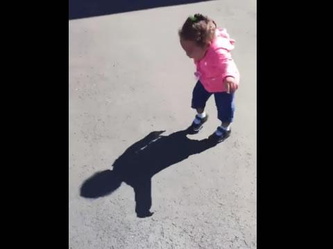 Baby girl afraid of her own shadow