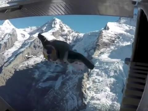 jump from a mountain into a plane