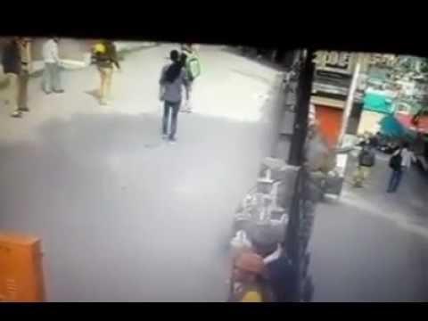 monkey kicks a man