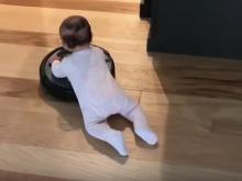 Baby Riding Roomba Vacuum Cleaner