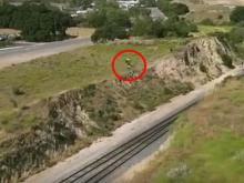 Motorcyclist Daring Jump Across Train Tracks