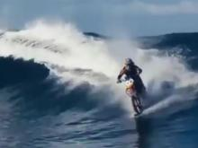 wave surfing on a dirt bike